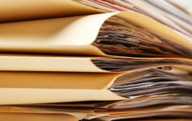 Stack of documents in file folders